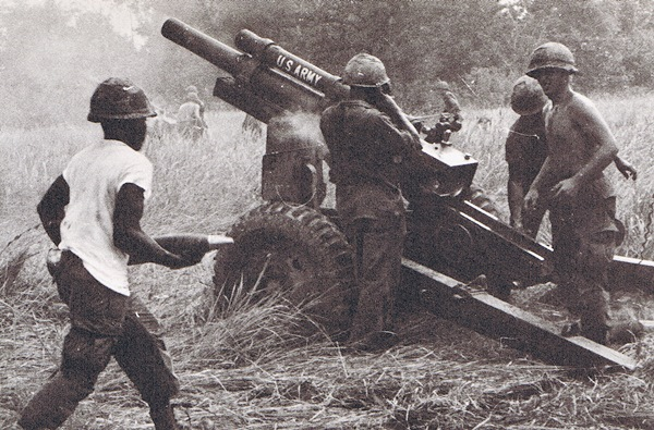 Vietnam War - First Infantry Division.  U.S. Army 2nd Battalion, 33rd  Field Artillery soldiers operate a 105 mm howitzer during a fire mission. Courtesy of First Infantry Division