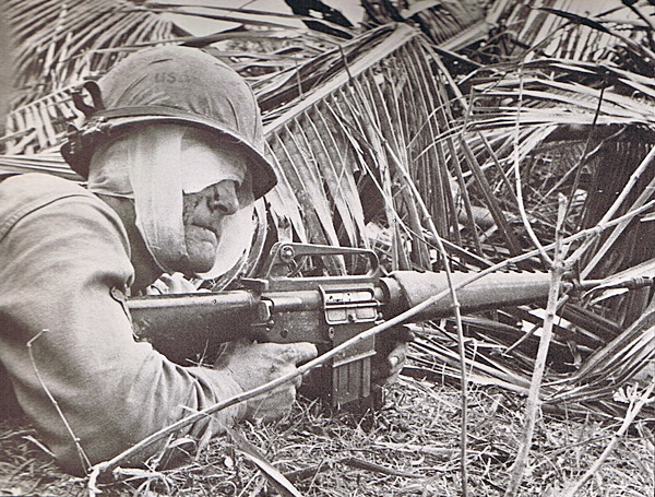 A wounded First Infantry Division solder keeps watch during the Vietnam War. Courtesy of First Infantry Division.