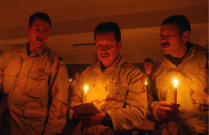 Soldiers pray during a candlelight prayer service in Mazar-e Sharif, Afghanistan, in celebration of Christmas