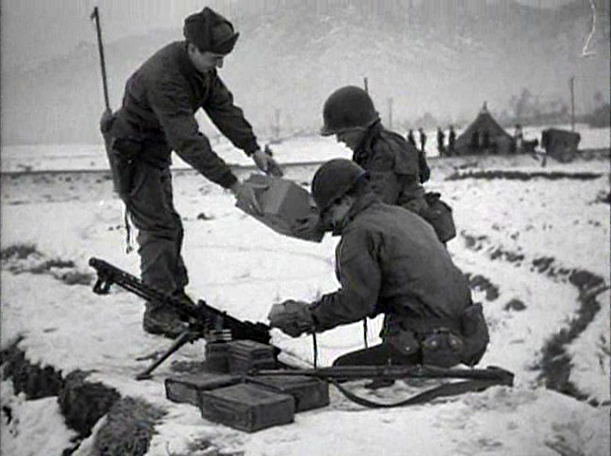 U.S. Soldiers receive Christmas packages during the Korean War, 1950.