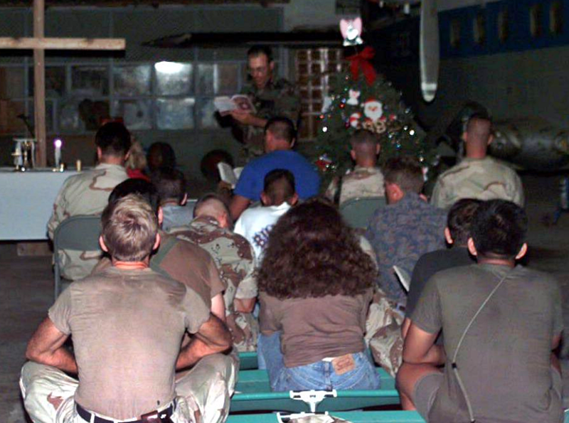 U.S. military personnel watch Christmas service in Mogadishu, Somalia.