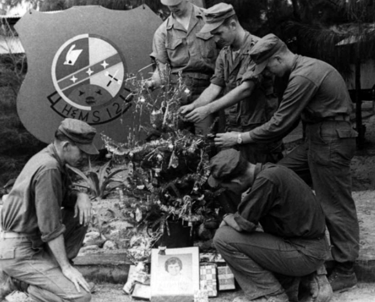Marines in Vietnam decorate a Christmas tree, 1967.