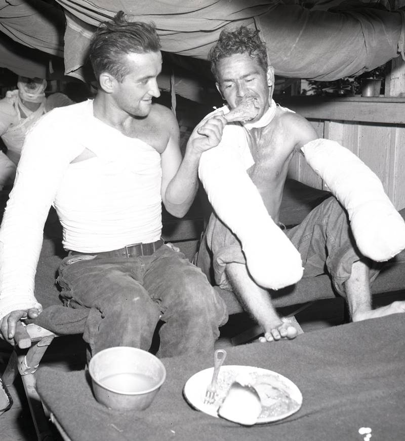 Wounded Soldiers enjoy Christmas dinner at a field hospital in the Philippines