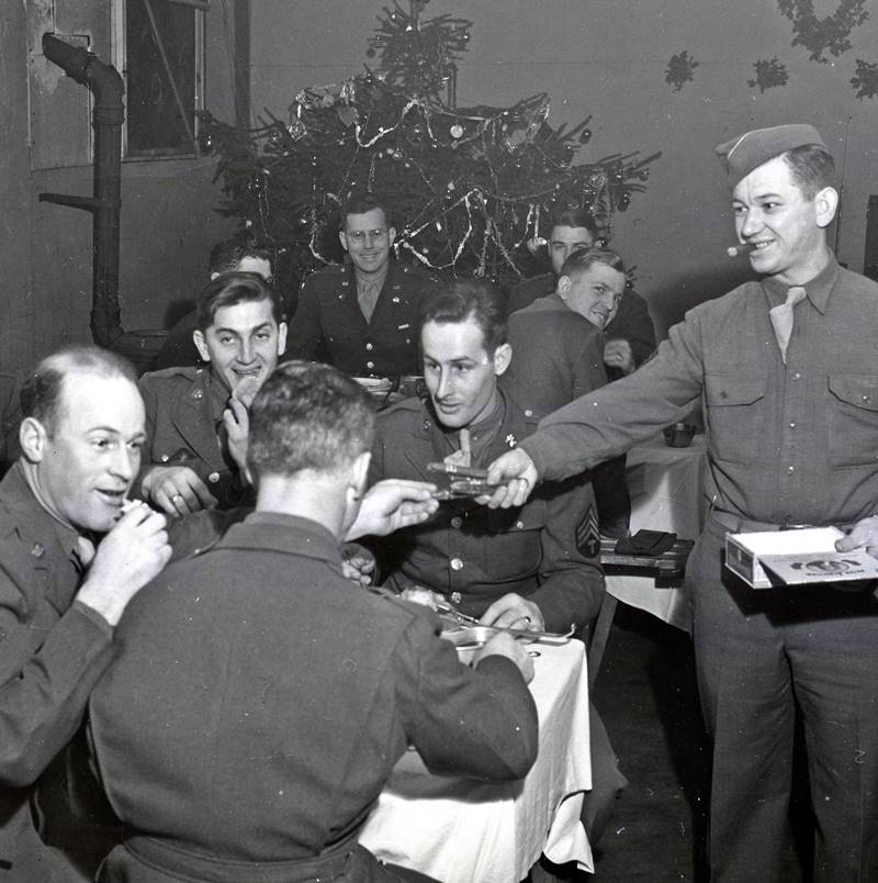 Soldiers of Company C, 56th Signal Battalion, V Corps enjoy Christmas festivities. World War II, England.