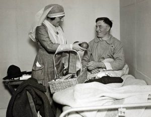 Wounded American Soldier receives Christmas gift from Red Cross worker