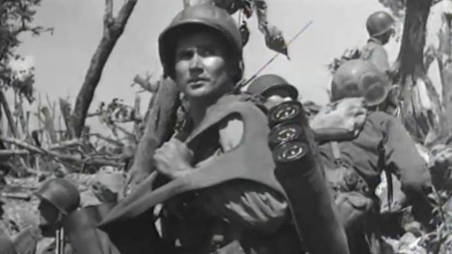 World War II soldier carrying a large load of equipment